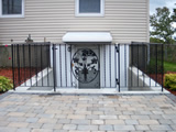 Wrought Iron Gate With A Floral Panel